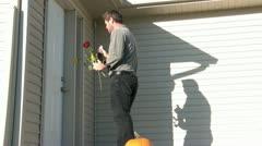 Man Brings Flowers & Champagne to Door Stock Footage
