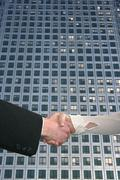 Handshake and skyscraper Stock Illustration