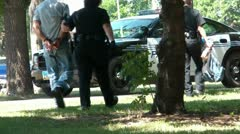 Man is Arrested & Handcuffed - Escorted to Police Car - stock footage