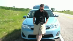 Man Leaning on Front of Car Stranded Stock Footage