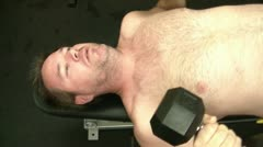 Man Lifting Weights - Bench Pressing Dumbbells Stock Footage