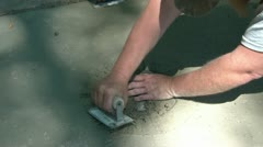 Man Smooths Cement with Trowel Stock Footage