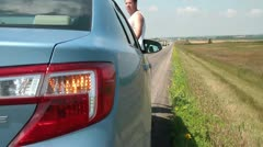 Man Stranded on Highway with Hazard Lights On Stock Footage