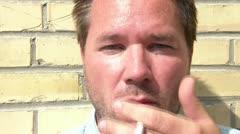 Man Smoking Cigarette - Close Up Stock Footage