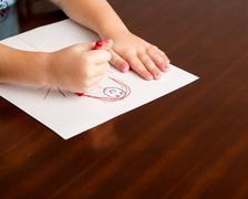 child drawing a little person - stock photo