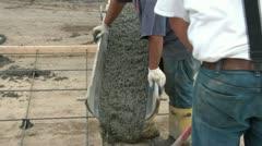 Men Pour Concrete for New Driveway - stock footage