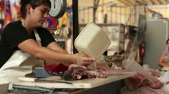 Mexican fish market young woman cutting meat HD 4382 Stock Footage