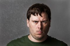 One mean looking guy about to cause problems Stock Photos