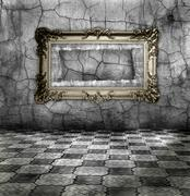carved gilded frame on silver wall - stock photo