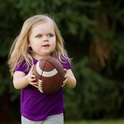 she is running for the touchdown - stock photo