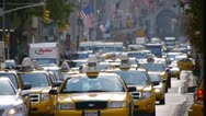 Yellow cabs taxi cars traffic in New York City Manhattan Park Avenue Stock Footage