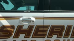 Pan of Sheriff Truck Stock Footage