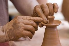 potter working with clay. - stock photo