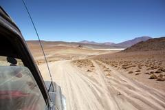 Cars on the desert road Stock Photos