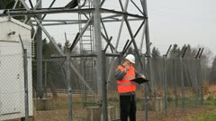 Engineer at GSM tower with a cell phone Stock Footage