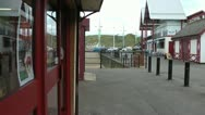 Stock Video Footage of Seafront amusement arcade entrance, surf shop & cafe