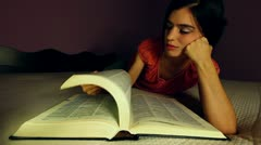 Young Adult Woman Reads a Book Stock Footage