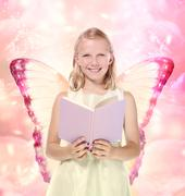 little blonde girl reading a book - fantasy - stock photo