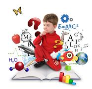 young science education boy on book thinking - stock photo