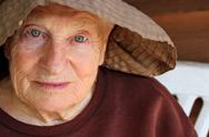 Portrait of senior woman in hat. Stock Photos