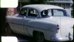 People in CLASSIC CAR Backs Up 1953 Chevrolet 210 Vintage Film Home Movie 5934 Stock Footage