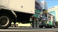 Low angle view of trams and traffic passing in Hiroshima, Japan Stock Footage