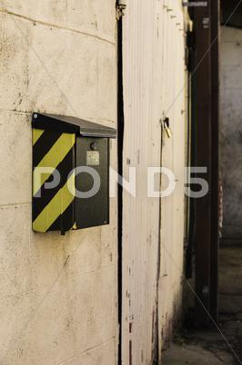 Stock photo of letterbox with a chevron on an exterior wall