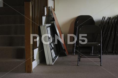 Stock photo of folding tables and chairs