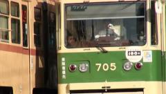 Japan, tram driver greets colleague, streetcar, public transport, Hiroshima Stock Footage
