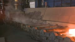 Hot steel on conveyor Stock Footage