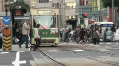 People are crossing a busy road in downtown Hiroshima, Japan Stock Footage