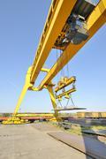 crane and steel plates - stock photo