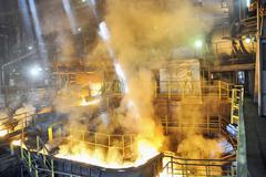 Molten hot steel pouring Stock Photos