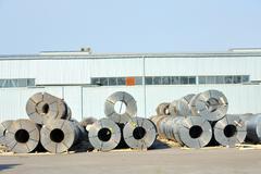 rolls of steel sheet in harbor - stock photo