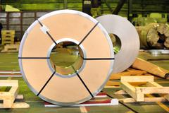 packed roll of steel sheet - stock photo