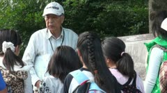 Teacher guide explains Japanese children about the Second World War, Hiroshima Stock Footage
