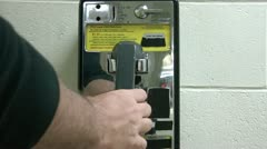 Picking Up Pay Phone & Dialing - stock footage