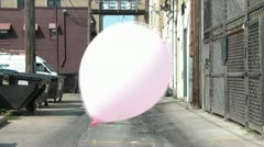 Pink Balloon Drifts in Alleyway - stock footage