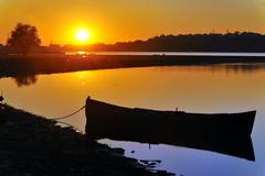 Stock Photo of old boat in sunset on danube river