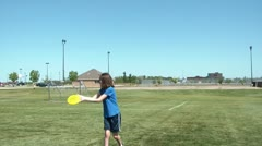 Playing Frisbee in Sun Stock Footage