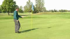 Playing Golf in Business Clothes Stock Footage