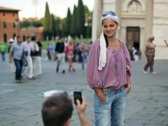 Couple taking photo with cellphone by Leaning Tower of Pisa NTSC Stock Footage