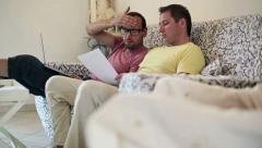 Gay couple in financial trouble at home, dolly shot HD Stock Footage