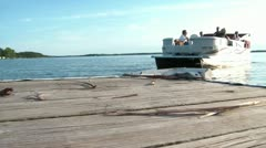 Pontoon Boat Leaving Dock - stock footage