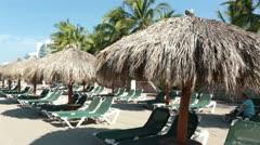 Beach umbrella lounge chair family fun tropical Mexico HD 4484 Stock Footage