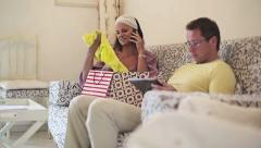 Couple in home with shopping bag and tablet, dolly shot HD Stock Footage