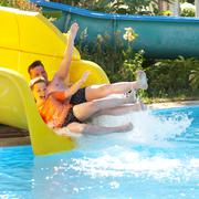 Father with the son on waterslide Stock Photos