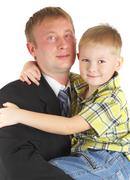 The son on hands of the father. happy family. Stock Photos