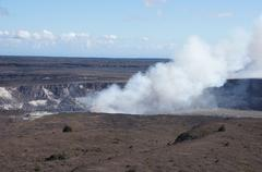 steam plume rising from active volcano - stock photo