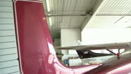 Stock Video Footage of Rear Pan of Maroon Airplane